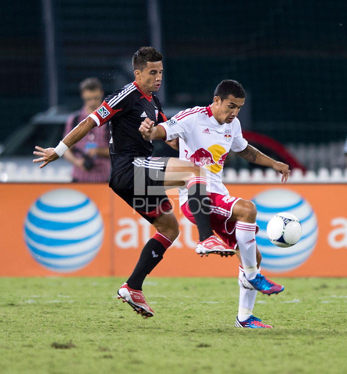 Marcelo Saragosa (11) of D.C. United tries to take the ball away from Tim Cahill (17) of the New York Red Bulls during the game at RFK Stadium in Washington, DC.  D.C. United tied the New York Red Bulls, 2-2.