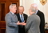 United States House Majority Leader Kevin McCarthy (Republican of California), left, engages in conversation with US Senate Minority Leader Chuck Schumer (Democrat of New York), left center, and US Senate Majority Leader Mitch McConnell (Republican of Kentucky), right center, and US Senate Majority Whip John Cornyn (Republican of Texas), right, looks on prior to the arrival of President Donald Trump at a reception for US House and US Senate Republican and Democratic leaders in the State Dining Room of the White House in Washington, DC on Monday, January 23, 2017.<br /> Credit: Ron Sachs / Pool via CNP
