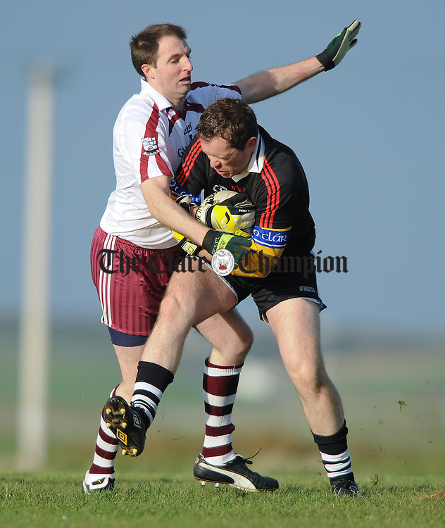 Niall Considine of Liscannor in action against Padraig Brennan of Ennistymon during their Cusack Cup game at Liscannor. Photograph by John Kelly.