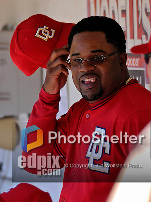 23 September 2007: Washington Nationals hitting coach Lenny Harris smiles in the dugout during a break in the action against the Philadelphia Phillies at Robert F. Kennedy Memorial Stadium in Washington, DC. The Nationals defeated the Phillies 5-3 in the historic last professional baseball game played at RFK Stadium.. .Mandatory Photo Credit: Ed Wolfstein Photo