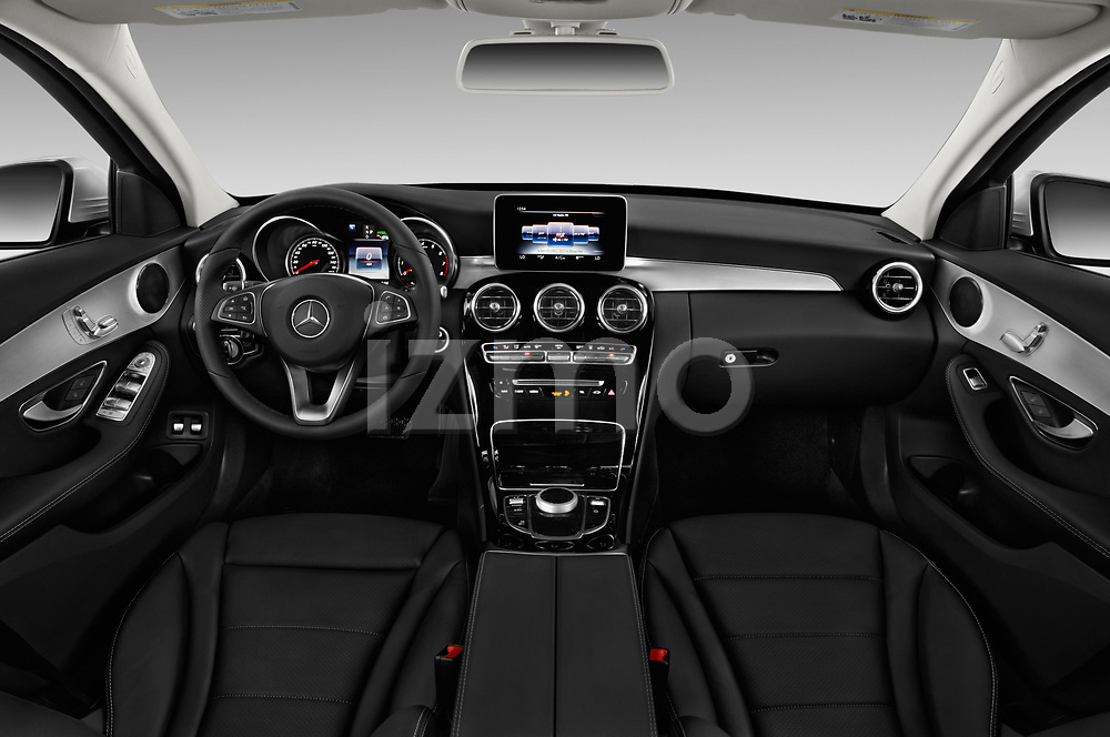 Stock photo of straight dashboard view of a 2017 Mercedes Benz C Class C350e 4 Door Sedan
