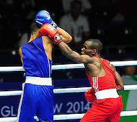Trinidad & Tobago's Michael Alexander (blue) defeats Nigeria's Joseph Oto (red) in their men's light (62kg) round of 32. <br /> <br /> Photographer Chris Vaughan/CameraSport<br /> <br /> 20th Commonwealth Games - Day 3 - Saturday 26th July 2014 - Boxing - SECC - Glasgow - UK<br /> <br /> © CameraSport - 43 Linden Ave. Countesthorpe. Leicester. England. LE8 5PG - Tel: +44 (0) 116 277 4147 - admin@camerasport.com - www.camerasport.com