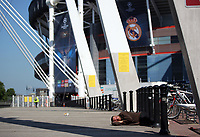 Pictured: A homeless man sleeps on the ground outside the National Stadium of Wales (aka Principality Stadium) Thursday 25 May 2017<br />Re: Preparations for the UEFA Champions League final, between Real Madrid and Juventus in Cardiff, Wales, UK.