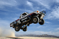 LAS VEGAS, NV - 1989: Robby Gordon jumps a berm in 1989 during an off-road test session near Las Vegas, Nevada.