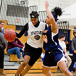 WATERBURY, CT-120818JS11- WCA's Leila Lazaro Aniyyah Watson (13) gets fouled by Kennedy's Aniyyah Watson (22) while driving to the basket during their Waterbury girls basketball jamboree game Saturday at Kennedy High School. <br /> Jim Shannon Republican American