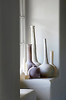 A window sill in the entrance hall displays a collection of contemporary vases