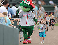Mascot Reedy Rip'It of the Greenville Drive enjoys Family FunDay with a fan prior to a game against the Rome Braves on May 6, 2012, at Fluor Field at the West End in Greenville, South Carolina. (Tom Priddy/Four Seam Images)