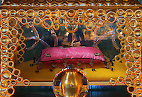 Reliquary of Saint Pierre Aumaitre, with a fragment of his femur on a pink cushion, by Cat-Berro, Orleans, and a gilded glass ball, in the Bell tower room themed 'Le Merveilleux' or The Supernatural, first floor, in Le Tresor de la Cathedral d'Angouleme, in Angouleme Cathedral, or the Cathedrale Saint-Pierre d'Angouleme, Angouleme, Charente, France. The 12th century Romanesque cathedral was largely reworked by Paul Abadie in 1852-75. In 2008, Jean-Michel Othoniel was commissioned by DRAC Aquitaine - Limousin - Poitou-Charentes to display the Treasure of the Cathedral in some of its rooms, which opened to the public on 30th September 2016. Picture by Manuel Cohen. L'autorisation de reproduire cette oeuvre doit etre demandee aupres de l'ADAGP/Permission to reproduce this work of art must be obtained from DACS.