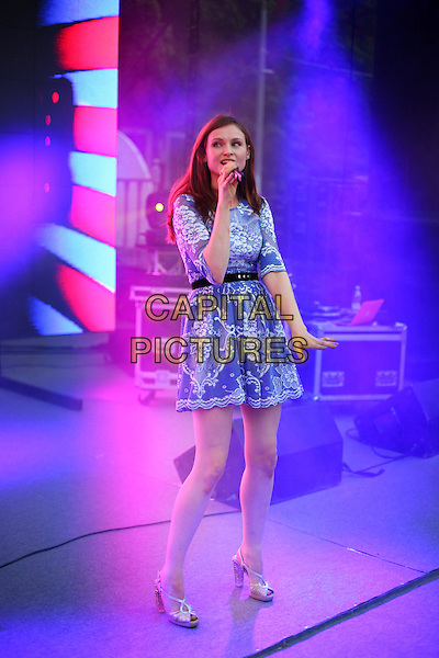 Sophie Ellis Bextor.Presentation of the TV channel 'Friday', Hermitage Garden, Moscow,.Russia, 7th August 2012..music live on stage performing performs concert gig full length blue lace dress white microphone singing belt black silver sandals .CAP/PER/AS.©AS/PersonaStars/CapitalPictures