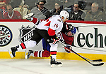17 October 2009: Ottawa Senators' defenseman Chris Campoli (14) checks Montreal Canadiens defenseman Jaroslav Spacek into the boards during the first period at the Bell Centre in Montreal, Quebec, Canada. The Senators defeated the Canadiens 3-1. Mandatory Credit: Ed Wolfstein Photo