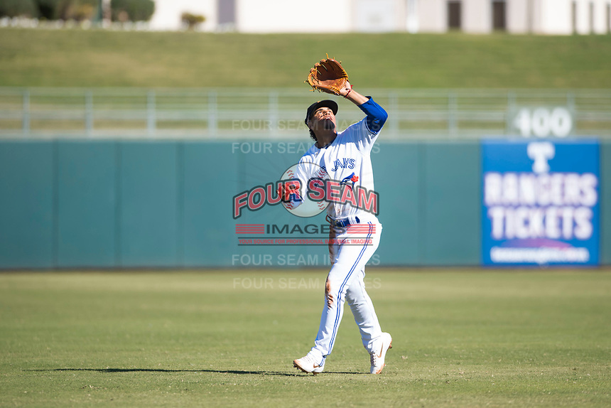 Surprise Saguaros shortstop Santiago Espinal (6), of the Toronto Blue Jays organization, prepares to catch a pop fly during an Arizona Fall League game against the Glendale Desert Dogs at Surprise Stadium on November 13, 2018 in Surprise, Arizona. Surprise defeated Glendale 9-2. (Zachary Lucy/Four Seam Images)