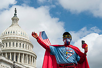 "Michael Wheeler, of Kansas City, MO, wears his ""Super Jesus"" outfit and face mask as he shouts his message outside of the U.S. Capitol in Washington, DC., Wednesday, May 27, 2020. Credit: Rod Lamkey / CNP/AdMedia"
