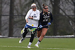 01 March 2015: Duke's Kyra Harney (10) tries to knock the ball away from Notre Dame's Casey Pearsall (24). The Duke University Blue Devils hosted the University of Notre Dame Fighting Irish on the West Turf Field at the Duke Athletic Field Complex in Durham, North Carolina in a 2015 NCAA Division I Women's Lacrosse match. Duke won the game 17-3.