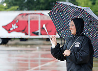 NWA Democrat-Gazette/DAVID GOTTSCHALK   Savannah Miller, a feature twirler, practices marching Wednesday, August 19, 2015 in the rain with the Razorback Marching Band on the campus of the University of Arkansas in Fayetteville. The 350 member band is now under the direction Ben Lorenzo.