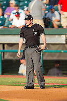 Home plate umpire Alex Ziegler between innings of the Southern League game between the Montgomery Biscuits and the Chattanooga Lookouts at AT&T Field on July 24, 2014 in Chattanooga, Tennessee.  The Biscuits defeated the Lookouts 6-4. (Brian Westerholt/Four Seam Images)