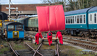 BNPS.co.uk (01202 558833)<br /> Pic: PhilYeomans/BNPS<br /> <br /> Fluctuating breezes at the Midland Railway near Butterley in Derbyshire meant the team had to push the craft for most of the day.<br /> <br /> To Hull and back...eccentric Inventor Phil Mathison has recreated the almost forgotten 'Spurn Landship'.<br /> <br /> Railway enthusiast Phil Mathison, 68, has researched and rebuilt the sail powered Spurn Landship, which once ferried people out along the windswept Spurn Peninsula east of Hull between the wars.<br /> <br /> The original 13 ft landship, made up of a large sail mounted on a wheeled trolley (bogie), could travel at a hair-raising 40mph. <br /> <br /> Mr Mathison, a retired economist, has been assisted on the four year project by his wife Mary, 68, and their Norwegian friend Torkel Larsen, 51. The trio have dubbed themselves the 'Spurnfleet Command' and wear astronaut-like uniforms.<br /> <br /> Despite exhaustive trials Phil and his team have only attained a top speed of 6mph so far, mainly due to fluctuating wind conditions on the test track in Derbyshire.