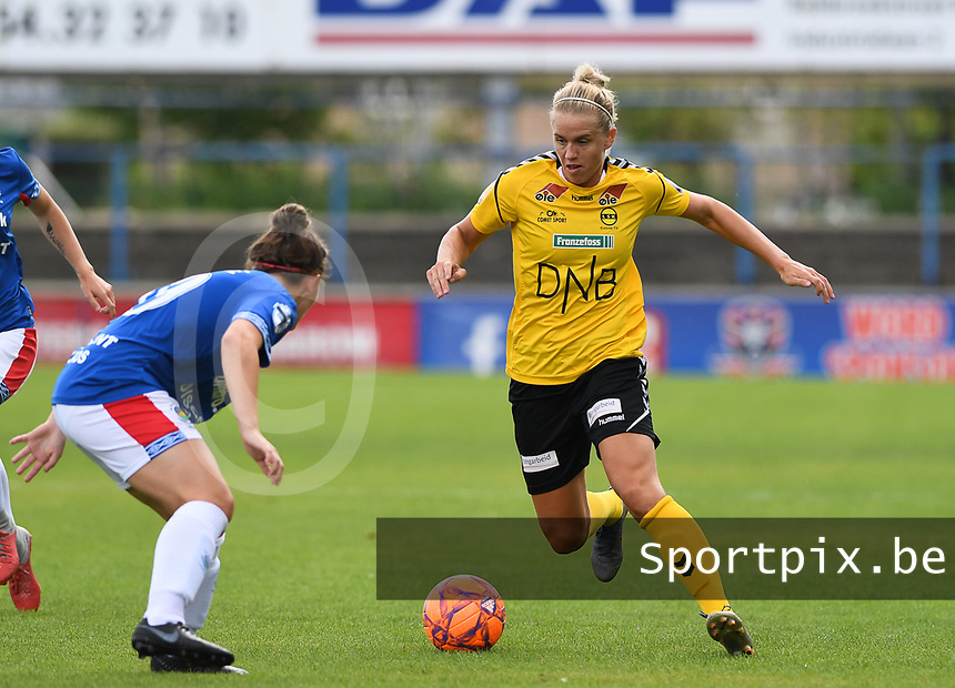 20190807 - DENDERLEEUW, BELGIUM : LSK's Elise Thorsnes pictured in action in front of Linfield's Abbie Magee (left) during the female soccer game between the Norwegian LSK Kvinner Fotballklubb Ladies and the Northern Irish Linfield ladies FC , the first game for both teams in the Uefa Womens Champions League Qualifying round in group 8 , Wednesday 7 th August 2019 at the Van Roy Stadium in Denderleeuw  , Belgium  .  PHOTO SPORTPIX.BE for NTB  | DAVID CATRY