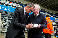 Swansea manager Paul Clement signs an autograph to an elderly supporter during the Premier League match between Swansea City and Everton at The Liberty Stadium, Swansea, Wales, UK. Saturday 06 May 2017
