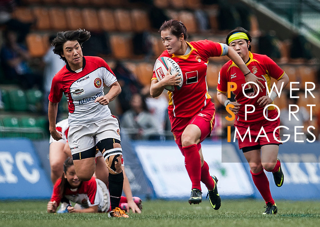 Players in action during the Hong Kong Women's Rugby Sevens 2013 at the Hong Kong Football Club on 22 March 2013. Photo by Xaume Olleros / The Power of Sport Images