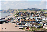 BNPS.co.uk (01202) 558833<br /> Picture: Peter Willows<br /> <br /> West Bay in Dorset, where ITV's Broadchurch was filmed.<br /> <br /> While the whole country has been enjoying the final series of TV drama Broadchurch, no one is relishing the show more than the businesses of West Bay.<br /> <br /> The 'Broadchurch effect' has sent visitor numbers to the sleepy Dorset town, where the show is set, skyrocketing in the past four years.<br /> <br /> And the latest, and final, series, which finishes on Monday, has only fanned the flames, with a host of new businesses benefiting from their association with the show.<br /> <br /> Tourism organisation Visit Dorset has experienced an increase of 133 per cent in enquries and bookings on its website.<br /> <br /> Local businesses which feature on screen have also seen their profits soar thanks to 'Broadies' who stop for a selfie before calling in to make a purchase.<br /> <br /> One premises in particular has been the Washingpool Farm Shop, which is Flintcombe Farm Shop run by Lenny Henry's character Ed Burnett in Broadchurch.