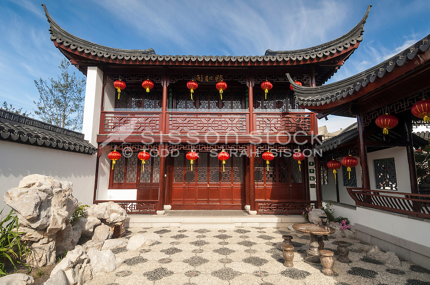 Bright red festive lanterns hang in front of the ornative wooden lattice work of the Tea house at the Dunedin Chinese Gardens, Otago, New Zealand - stock photo, canvas, fine art print