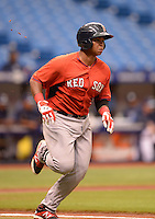 Boston Red Sox third baseman Rafael Devers (12) runs to first during an Instructional League game against the Tampa Bay Rays on September 25, 2014 at the Tropicana Field in St. Petersburg, Florida.  (Mike Janes/Four Seam Images)