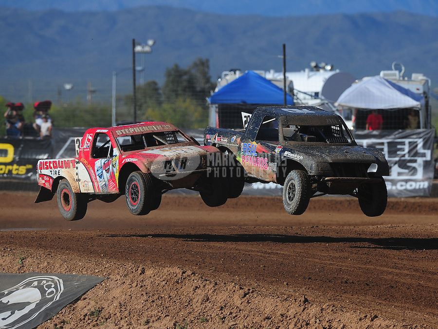 Apr 16, 2011; Surprise, AZ USA; LOORRS driver Richard Cassey (29) races alongside Jimmy Stephensen (33) during round 3 at Speedworld Off Road Park. Mandatory Credit: Mark J. Rebilas-.