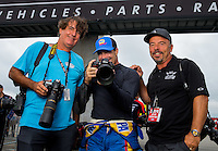Aug 31, 2014; Clermont, IN, USA; NHRA funny car driver Ron Capps (center) poses with photographers Ron Lewis (left) and Gary Nastase during qualifying for the US Nationals at Lucas Oil Raceway. Mandatory Credit: Mark J. Rebilas-USA TODAY Sports