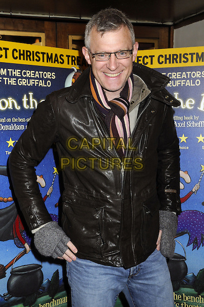 Jeremy Vine .Attending a special VIP performance of 'Room On The Broom' at the Lyric Theatre, London, England, UK, .December 1st 2012..half length glasses jeans scarf brown leather jacket grey gray fingerless gloves .CAP/BK/PP.©Bob Kent/PP/Capital Pictures