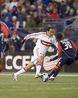 Chicago Fire midfielder Cuauhtemoc Blanco (10) dribbles as New England Revolution defender Kevin Alston (30) defends. The New England Revolution tied the Chicago Fire, 0-0, at Gillette Stadium on October 17, 2009.