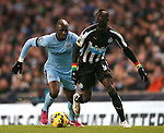 Eliaquim Mangala of Manchester City and Papiss Demba Cisse of Newcastle United - Barclays Premier League - Manchester City vs Newcastle Utd - Etihad Stadium - Manchester - England - 21st February 2015 - Picture Simon Bellis/Sportimage