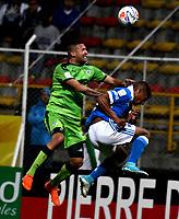 BOGOTA - COLOMBIA -25 - 11 - 2017: Jeider Riquet (Izq.) jugador de La Equidad disputa el balón con Harold Mosquera (Der.) jugador de Millonarios, durante partido de ida entre La Equidad y Millonarios, de los cuartos de final la Liga Aguila II - 2017, jugado en el estadio Metropolitano de Techo de la ciudad de Bogota. / Jeider Riquet (L) player of La Equidad vies for the ball with Harold Mosquera (R) player of Millonarios, during a match for the first leg between La Equidad and Millonarios, to the quarter of finals for the Liga Aguila II - 2017 at the Metropolitano de Techo Stadium in Bogota city, Photo: VizzorImage  / Luis Ramirez / Staff.