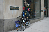Two bicycles parked outside Simmons store in downtown Montreal,Quebec