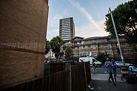 Another Tower Block in the Area.<br /> <br /> London, 14/06/2017. Documenting the aftermath of the tragic blaze of the Grenfell Tower and the immediate reaction of Londoners, and other members of the public, who actively rallied to assist the residents and the neighbours who survived this horrific fire, showing solidarity and donating food, water, toys and clothes.  <br /> Today at 00:54 BST, a huge and very fast fire engulfed the 24-storey block, Grenfell Tower, in north Kensington. Seventeen people have died and many residents remain missing. Thirty patients are still in hospital, seventeen people of whom are in critical conditions. Forty-five fire engines and more than 200 firefighters were called to extinguish the blaze, which was under control at 01:14 BST on Thursday. The Grenfell Tower was built in 1974 as public housing flats. It is managed by Kensington and Chelsea Tenant Management Organisation (KCTMO), the largest tenant management organisation in England, working on behalf of Kensington &amp; Chelsea Council. The tower block contains about 127 flats and between 400 and 600 people live in the building. The 'Safety Instructions' of the tower told people to &quot;stay put&quot; in their flat in case of fire. &lt;&lt;[&hellip;] Since 2013 the residents' organisation, Grenfell Action Group, had repeatedly expressed concern about fire safety and had warned in November 2016 that only a catastrophic fire would finally force the block's management to treat fire precautions and maintenance of fire-related systems to a proper standard [&hellip;]&gt;&gt; (Source &ndash; Wikipedia.org). The tower was renovated in 2015&ndash;16 with a &pound;10 million refurbishment project, which included new windows and new aluminium composite cladding and Reynolux material with thermal insulation (Caption updated on 15 June 2017, 22:42 BST).<br /> <br /> Met Police emergency number: 0800 0961 233<br /> <br /> For more info click here: https://en.wikipedia.org/wiki/Grenfell_Tower_fi