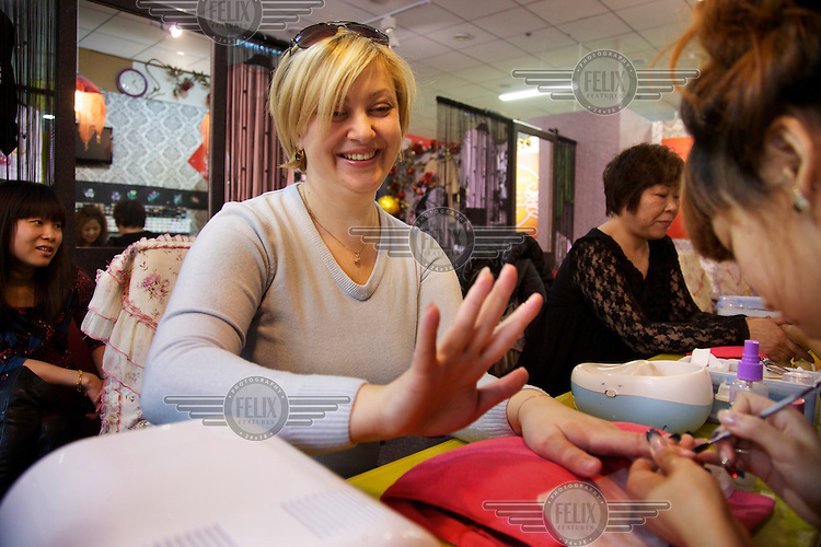 Viktoria, 39, from the Russian city of Khabarovsk, travelled 1200 km to the border town of Heihe to enjoy a manicure and to shop.