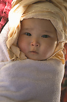 Little Tibetan girl after bath, Tsewang's daughter.