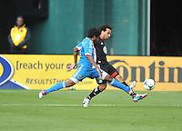 Dwayne De Rosario (7) of D.C. United goes against Sheanon Williams (25) of the Philadelphia Union. The Philadelphia Union defeated D.C. United 3-2, at RFK Stadium, Sunday April 21, 2013.