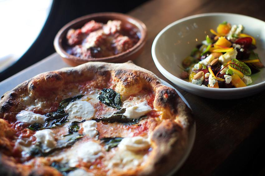 Jersey City, NJ - April 27, 2016: Pizza, Meatballs and Beet Salad at Razza Pizza Artigianale, a brick oven pizzeria by chef Dan Richer in Jersey City.<br /> <br /> CREDIT: Clay Williams for Gothamist<br /> <br /> &copy; Clay Williams / claywilliamsphoto.com