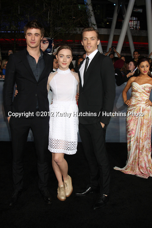"LOS ANGELES - NOV 12:  Max Irons, Saoirse Ronan, Jake Abel arrive to the 'The Twilight Saga: Breaking Dawn - Part 2"" Premiere at Nokia Theater on November 12, 2012 in Los Angeles, CA"