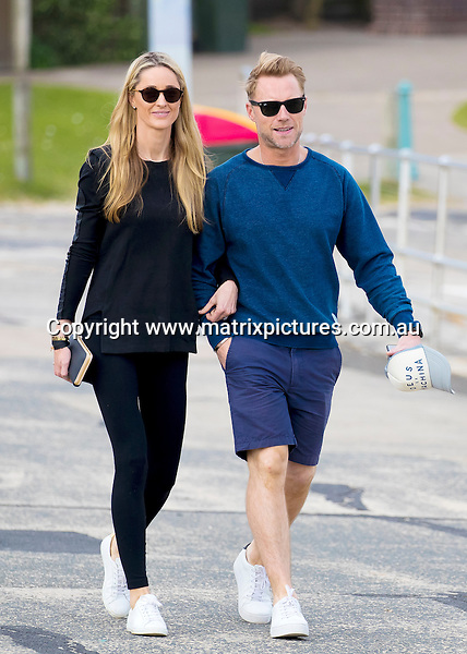 7 JUNE 2016 NOOSA AUSTRALIA<br /> WWW.MATRIXPICTURES.COM.AU<br /> <br /> EXCLUSIVE PICTURES<br /> <br /> Ronan Keating pictured with his wife Storm Keating walking along Bondi Beach <br /> <br /> *ALL WEB USE MUST BE CLEARED*<br /> <br /> Please contact prior to use:  <br /> <br /> +61 2 9211-1088 or email images@matrixmediagroup.com.au <br /> <br /> Note: All editorial images subject to the following: For editorial use only. Additional clearance required for commercial, wireless, internet or promotional use.Images may not be altered or modified. Matrix Media Group makes no representations or warranties regarding names, trademarks or logos appearing in the images.