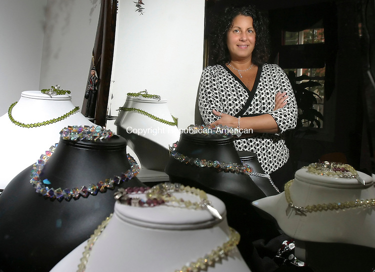 WATERBURY, CT; 19 OCTOBER 2006; 101906BZ12- Rena Gugliotti, owner-designer of Gemstonze, poses with some of her handmade Swarovski  jewelry Thursday afternoon. <br /> Jamison C. Bazinet Republican-American