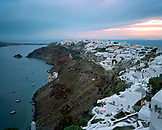 GREECE, Santorini, Oia, homes, restaurants and villas cover the top of the cliffs of Oia, the Mediterranean Sea