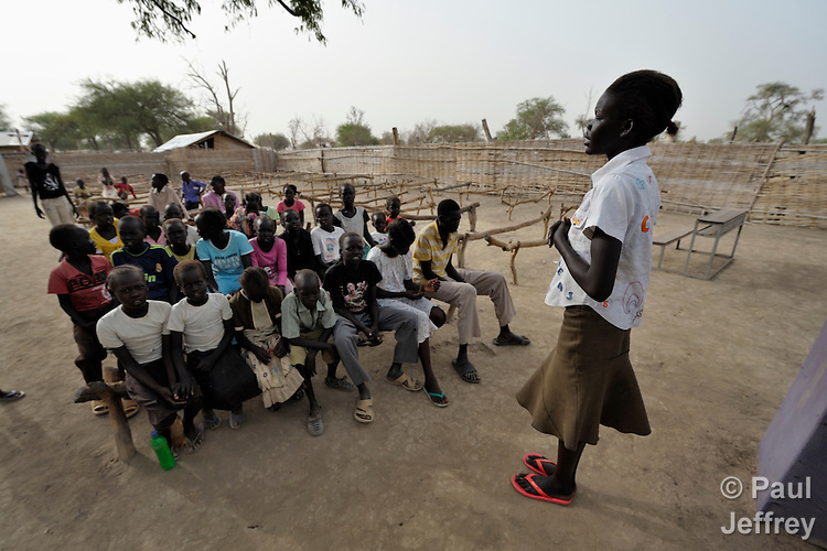 A young woman leads a Roman Catholic catechism class in Agok, a town in the contested Abyei region where tens of thousands of people fled in 2011 after an attack by soldiers and militias from the northern Republic of Sudan on most parts of Abyei. Although the 2005 Comprehensive Peace Agreement called for residents of Abyei--which sits on the border between Sudan and South Sudan--to hold a referendum on whether they wanted to align with the north or the newly independent South Sudan, the government in Khartoum and northern-backed Misseriya nomads, excluded from voting as they only live part of the year in Abyei, blocked the vote and attacked the majority Dinka Ngok population. The African Union has proposed a new peace plan, including a referendum to be held in October 2013, but it has been rejected by the Misseriya and Khartoum. The Catholic parish of Abyei, with support from Caritas South Sudan and other international church partners, has maintained its pastoral presence among the displaced and assisted them with food, shelter, and other relief supplies