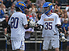 Sean Crotty #35 of Kellenberg, right, and Matthew Sluka #20 celebrate after a goal in the fourth quarter of the CHSAA varsity boys lacrosse Class AA Intersectional Final against Iona Prep at Kellenberg High School on Friday, May 26, 2017. Kellenberg won by a score of 11-9.