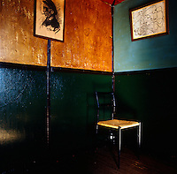 A chair stands in the corner of the former Etoile de Mer restaurant which is decorated with paintings by Le Corbusier