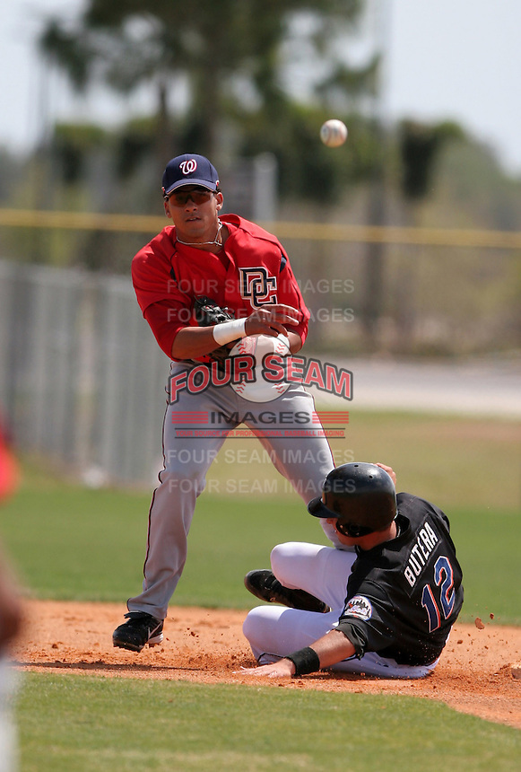 Washington Nationals minor leaguer Ian Desmond attempts a double play as Drew Butera slides in during Spring Training at the Carl Barger Training Complex on March 20, 2007 in Melbourne, Florida.  (Mike Janes/Four Seam Images)