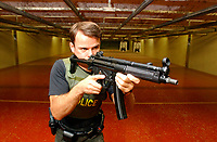 2001 File Photo, Montreal, Quebec, Canada; <br /> <br /> A Quebec provincial police (Surete du Quebec) officer demonstrate a Heckler & Kock  9 mm sub machine gun at the Police firing range in Montreal<br /> <br /> (Mandatory Credit: Photo by Sevy - Images Distribution (©) Copyright 2002 by Sevy<br /> <br /> NOTE :  D-1 H original JPEG, saved as Adobe 1998 RGB.<br />  Uncompressed and uncropped original  size file available on request.