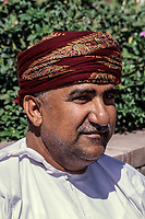 Muscat, Oman.  Middle-aged Omani Man Wearing a Traditional Msarr.