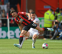 Bournemouth's Adam Smith (right) is tackled by Sheffield United's Enda Stevens (left)<br /> <br /> Photographer David Horton/CameraSport<br /> <br /> The Premier League - Bournemouth v Sheffield United - Saturday 10th August 2019 - Vitality Stadium - Bournemouth<br /> <br /> World Copyright © 2019 CameraSport. All rights reserved. 43 Linden Ave. Countesthorpe. Leicester. England. LE8 5PG - Tel: +44 (0) 116 277 4147 - admin@camerasport.com - www.camerasport.com