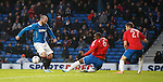 Kris Boyd has a fresh air swipe in front of goal